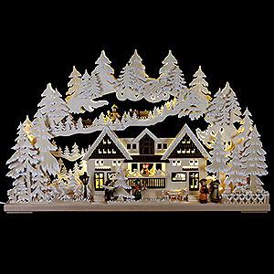 Schwibbögen Laubsägearbeiten 3D-Schwibbogen Weihnacht am Geschenkehaus mit Raureif - 72x43 cm