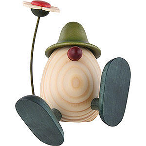 Geschenkideen Ostern Eierkopf Alfons mit Blume sitzend/tanzend, grün - 11 cm
