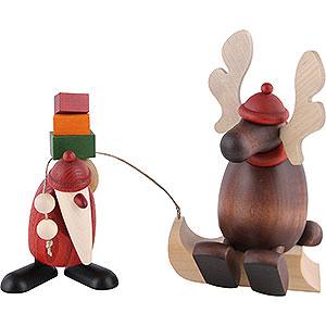 Kleine Figuren & Miniaturen Björn Köhler Weihnachtsfrauen kl. Weihnachtsmann mit Faultier (Elch auf Schlitten) - 15,5 cm