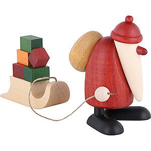 Kleine Figuren & Miniaturen Björn Köhler Weihnachtsmänner kl. Weihnachtsmann mit Geschenkeschlitten - 9 cm