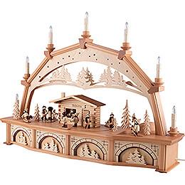 Schwibbogen Waldhaus mit Winterkindern und beweglichen Figuren - 76x52 cm
