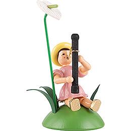 Blumenkind mit Anthurie und Fagott sitzend, farbig - 11 cm