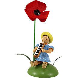 Blumenkind mit Mohnblume und Melodika sitzend - 12 cm