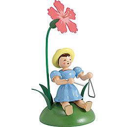 Blumenkind mit Nelke und Triangel sitzend - 12 cm