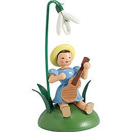 Blumenkind mit Schneeglöckchen und Gitarre sitzend - 12 cm