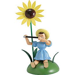 Blumenkind mit Sonnenblume und Querflöte sitzend - 12 cm