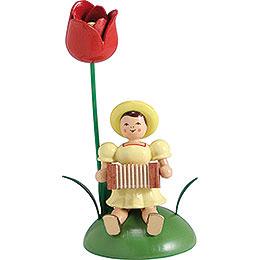 Blumenkind mit Tulpe und Harmonika sitzend - 12 cm