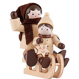 Thiel-Figur Schlittenfahrerin mit Kind - natur - 5,5 cm