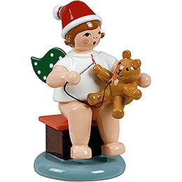 Weihnachtsengel sitzend mit Mütze und Teddy - 6,5 cm